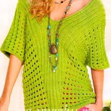 Необычный женский пуловер спицами с крупным сетчатым узором