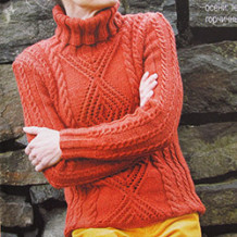 Женский свитер с крупными ажурными ромбами  и жгутами